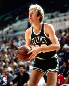 Larry Bird attempts a shot